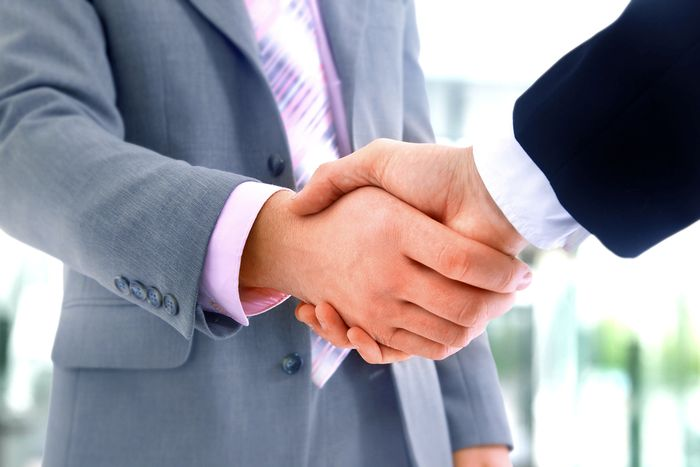 bigstock-handshake-in-office-13871237